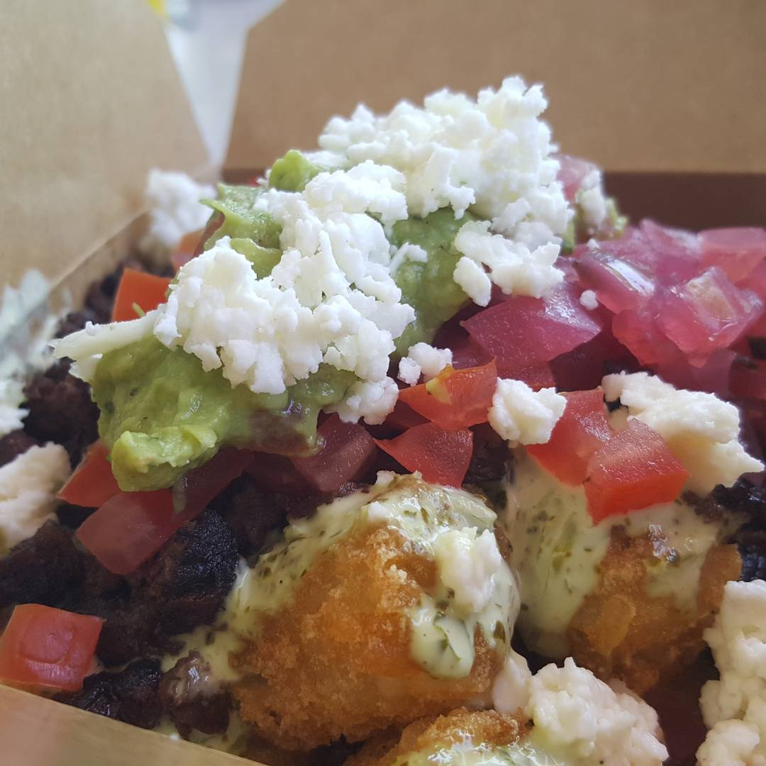 Went to @burntzilla for lunch. Got these for free! Carne asada tater tots. #burntzilla, I call it sophisticated street food.