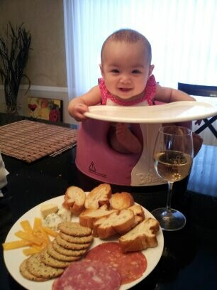 She can't eat solids yet, but I'm sure she'll like cheese & deli platters like we do.