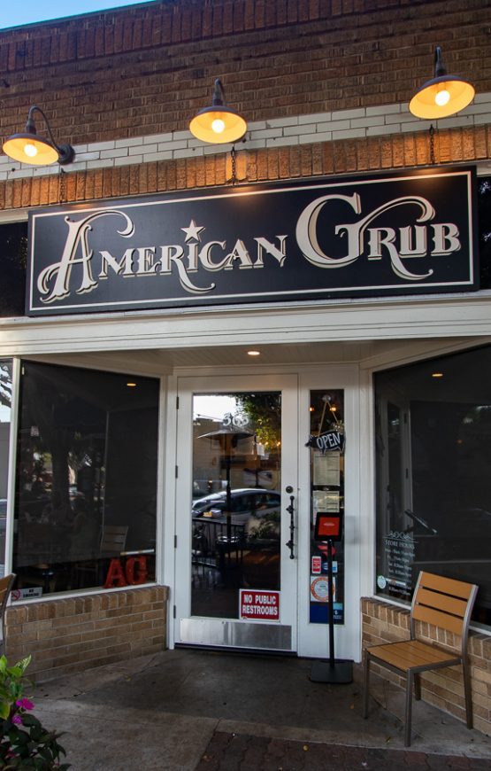 "Photo of the entrance for the restaurant, it reads ""American Grub"""