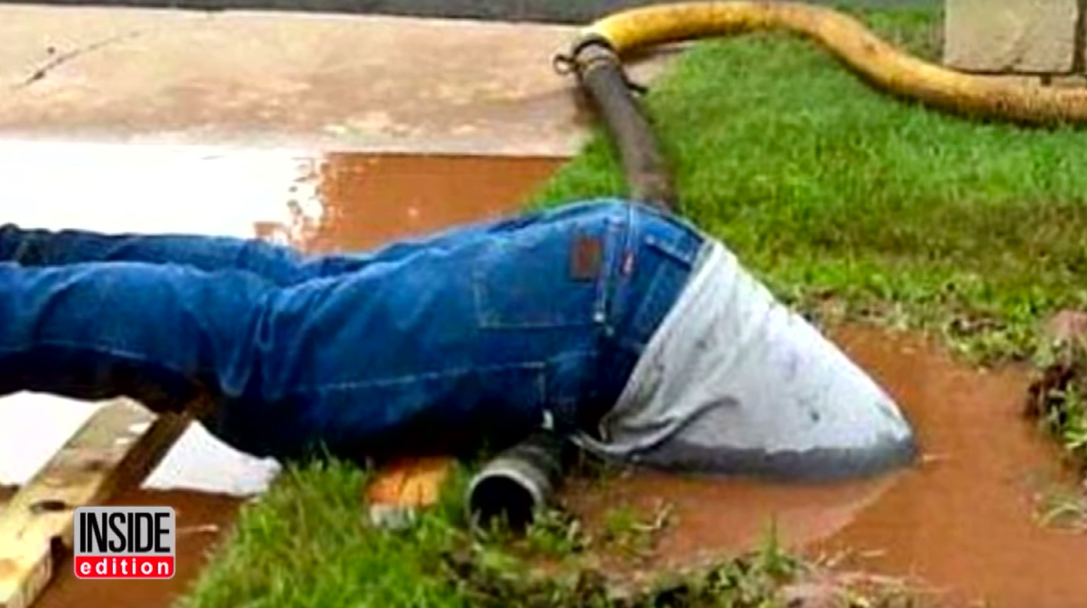 Picture of Jimmie Cox (plumber) submerged to fix a broken pipe