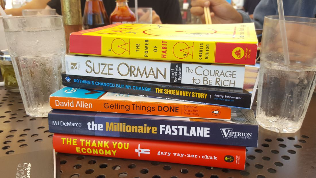 Stack of various business related books