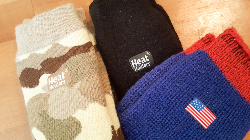 Three different pairs of heat holders. Camouflage, Black and US Flag.