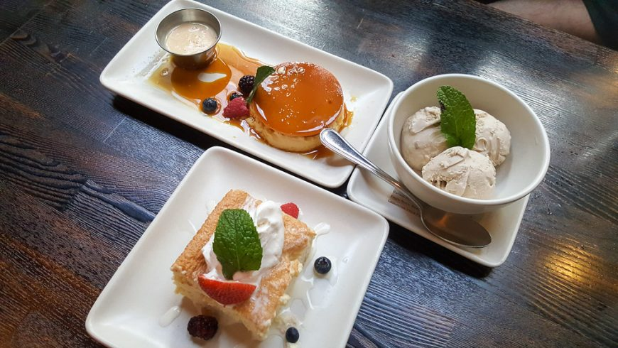 A trio of desserts. Flan, churro ice-cream and tres leches cake.